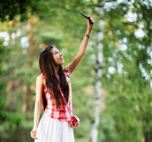 Young woman trying to catch cell phone signal Royalty Free Stock Photo