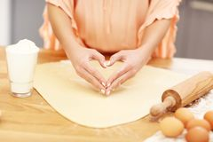 Young woman trying to cook something in kitchen Stock Photo