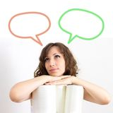 Young woman trying to make a decision. Over white background Royalty Free Stock Photos