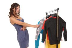Woman trying to pick clothes. Young woman trying to pick clothes Stock Image