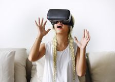 A young woman trying on VR headset royalty free stock photos