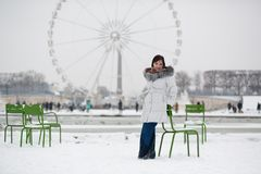 Young woman in Tuileries garden on a winter day Royalty Free Stock Image