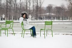 Young woman in Tuileries garden on a winter day Royalty Free Stock Photos