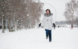 Young woman in Tuileries garden on a winter day Stock Photos