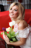 Young woman with tulips Royalty Free Stock Photos