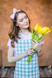 Young woman with tulips royalty free stock photo