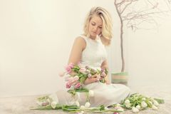 Young woman with tulips. Spring portrait of a young woman with tulips Royalty Free Stock Images