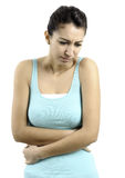 Young woman with tummyache. Woman holding her stomach with her hands. attractive young woman tummyache Stock Photos