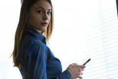 Free Young Woman Turning To Stare At The Camera Stock Photos - 97247713