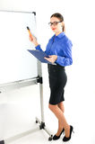 Young Woman Tutor Standing Near The School Board. Young Woman Leads A Lecture Royalty Free Stock Photography