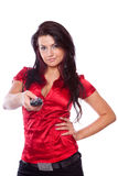 Young woman with TV remote control Stock Photo