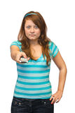 Young woman with tv remote control Royalty Free Stock Photos