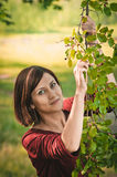 Young woman with twig of mulberry Royalty Free Stock Image
