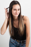 Young woman twisting her hair Royalty Free Stock Photo