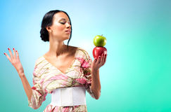 Young woman with two apples Stock Photography