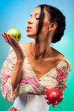 Young woman with two apples Royalty Free Stock Images