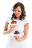 Young woman with two cakes Stock Photography