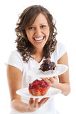 Young woman with two cakes Stock Image
