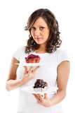 Young woman with two cakes Royalty Free Stock Image