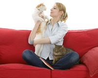 Young woman with two cats Stock Images