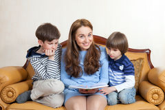 Young woman with two children Stock Photography