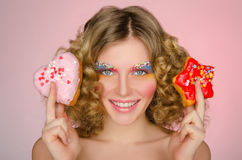 Young woman with two donuts Royalty Free Stock Photo