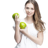 Young woman with two green apples Stock Photos