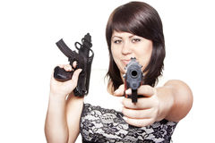Young woman with two guns Stock Photo
