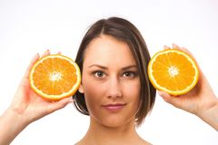 Young woman and two halves of orange Stock Photo