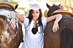 Young woman with two horses Royalty Free Stock Photography