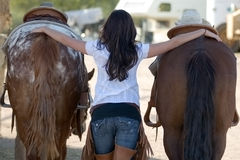 Young woman with two horses Royalty Free Stock Photos