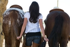 Young woman with two horses Royalty Free Stock Images
