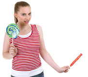 Young woman with two lollipops Royalty Free Stock Photos