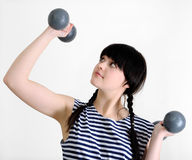 Young woman with two old dumbbells Stock Photos