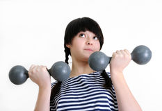 Young woman with two old dumbbells Royalty Free Stock Image