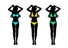 Young woman in two-pieces swimsuit taking sunbath silhouettes se Stock Images
