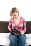 Young woman with two rabbits on her laps Stock Images