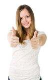 Young woman with two thumbs up. Beautiful young woman in white t-shirt with two thumbs up Royalty Free Stock Photo