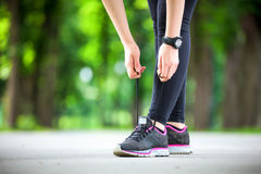 Young woman tying her laces before a run. Stock Photo