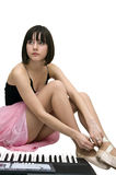 Young woman tying pointe shoes. Young woman tying pointe shoes sitting on the floor Royalty Free Stock Photo