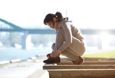 Young woman tying shoe lace before run Stock Photography