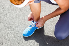 Young Woman Tying Sports Shoes. Stock Photography
