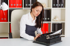 Young woman with typewriter. Royalty Free Stock Photo
