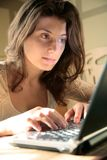 Young woman typing Stock Images