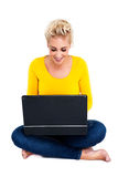 Young Woman Typing on Laptop Stock Photo