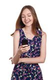 Young woman typing message in smart phone Stock Photos
