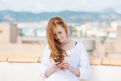 Young woman typing an sms Royalty Free Stock Image