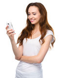 Young woman is typing sms message on her phone Royalty Free Stock Images