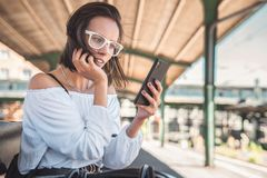 Young woman typing sms on smartphone royalty free stock photos