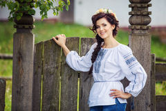 Young woman in Ukrainian style clothing outdoors Stock Image
